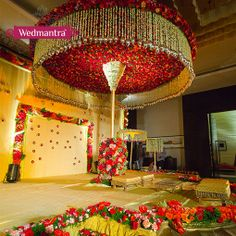 A grand stage decorated with a canopy of flowers. #wedmantra #weddinginindia…