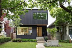 This black house in Vancouver, Canada, has some nice curb appeal with a fully landscaped front yard.