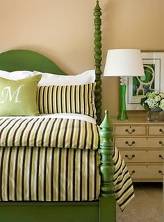 An old spindle bed pops in vivid kelly/emerald green.  A sisal-colored wall is the perfect restful backdrop.  Add a bright lamp and framed picture and you've got everything you need...