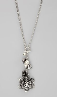 Silver Flower Pendant Necklace. The flower is exactly like a pair of earrings I got for Christmas.