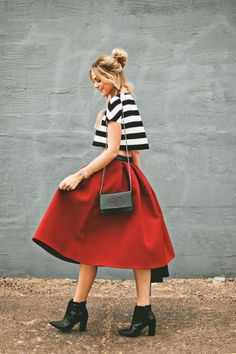 Black and white striped top with red midi skirt
