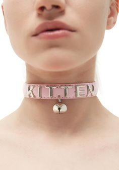 """NecroLeather Beloved Kitten Bell Collar cuz we alwayz wanna know where yer going, kitten. This adorable bell collar features hand-set metal letter studs that spell out """"KITTEN,"""" on a durable light pink vegan leather choker, and an attached bell charm, complete with a D-ring and buckle closure."""