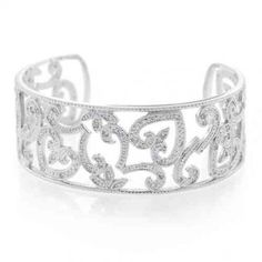 Be radiant in this sterling silver flower and hearts bracelet. Style and grace make up this stunning cubic zirconia accented cuff bracelet. The beautiful fleur de lis and hearts are crafted from 925 sterling silver and designed with an cut out motif. Sterling Silver Flowers, Sterling Silver Bracelets, Heart Bracelet, Cuff Bracelets, Bridal Flowers, Wholesale Jewelry, Bling Jewelry, Jewels, Jewelery