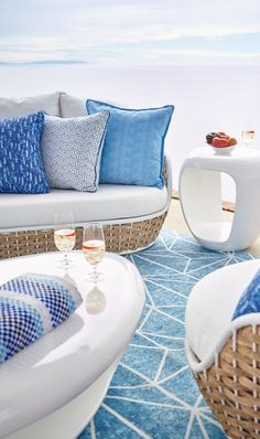 Morning in Santorini. Evoked by a crisp blue-and-white palette and casual wide-weave wicker. Outdoor Rooms, Outdoor Sofa, Outdoor Furniture, Modern Outdoor Living, Visual Texture, House With Porch, Decks And Porches, Luxury Home Decor, Wicker