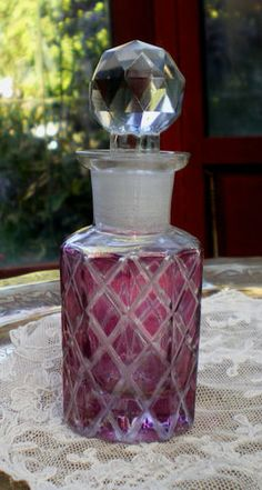 Victorian cranberrye glass perfume bottle, cut crystal stopper.