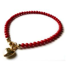 This bright red bracelet is all you need to put you, or someone special, in the mood for love. Description from bouf.com. I searched for this on bing.com/images