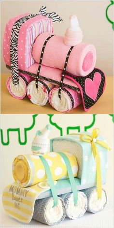Baby shower train gift with bibs, burp cloths, socks, diapers, ribbon, blankets, etc