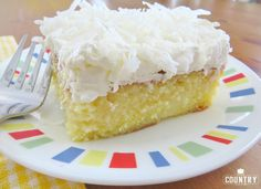 Pina Colada Poke Cake is made easy by using a butter boxed cake mix poked with cream of coconut. It's non-alcoholic. Topped with COOL WHIP and coconut!