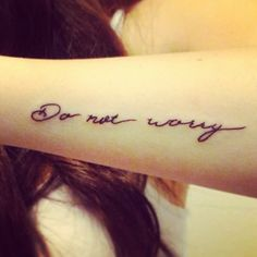 """Little forearm tattoo saying """"Do not worry"""" on Danielle Audry."""