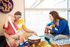Four Diamonds child Trey, age 3 with music therapist, Tina, at Penn State Hershey Children's Hospital