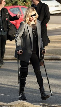 Hobbling about: Kate Moss was seen with a pair of crutches as she ventured out in north Lo...