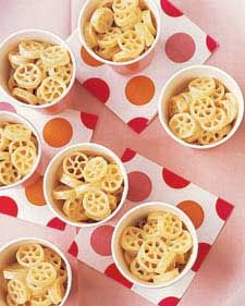 Put a new spin on macaroni and cheese with pasta wagon wheels. Spoon into little paper cups for easy serving.