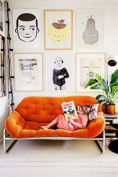 orange couch and gallery wall