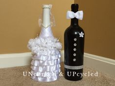 A groom in his tux and a bride in her gown. The Groom is on a black spray painted wine bottle with silver/crystal ribbon and buttons and a white bow tie. The bride has layers of fabric around the base and decorative flowers around the waistline. Ribbon up the neck of bottle and an outline of pearl embellishments around the top. She even has a veil! Makes a great engagement or wedding gift and a standout decoration for the bridal shower or wedding. All bottles are spray painted with several…