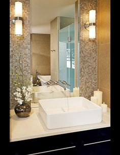 Like the use of the mirror, use less sheets of mosaic tiles for a focal wall.  Some glass mosaic tile can be rather expensive. #celebrityhomes