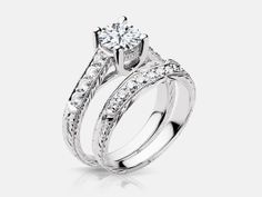 Helena style diamond engagement ring set with 0.38 carats of side diamonds with a milgrain edge and Art Deco inspired metal work in 14k white gold.
