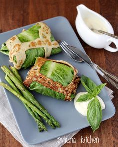 Green letuce crepes with asparagus, basil and sour cream