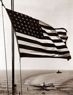 In World War II, the American Flag had 13 stripes, and 48 stars, with the stars arranged in rows and columns in a regular pattern (When Alaska and Hawaii became states, the pattern of stars was offset to accommodate the two new stars).