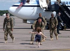 15 Emotional Photos of Soldiers Coming Home - A joyful daughter reuniting with her father.