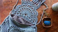 Some of you are probably familiar with this lovely crochet bag from Free People. I thought maybe try make one- not exactly like it - but just the idea of using a doily pattern for the bag.