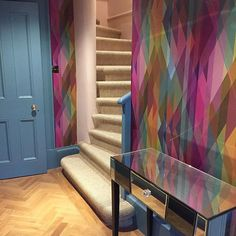 Hooray! The sisal basement stair carpet is finally in, so here's a wider view of the basement hallway complete with @cole_and_son_wallpapers Prism wallpaper (and small muddy footprints on the parquet, if you look closely enough...) #staircarpet #basementdecor #hallwaydecor #renovation #homedecor #coleandson #prism #multicoloured #capturingcolour #parquetfloor #mirroredtable #farrowandball #stoneblue #colorshare #pursuepretty #flashesofdelight #interiordesign #interiordecor…