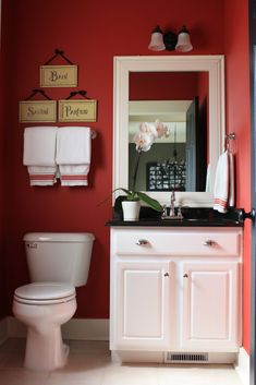 BUILDER GRADE BATHROOM GETS A CUSTOM LOOK- I'm not a fan of the dark red, but love everything else