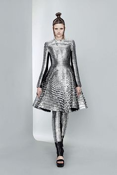 This design is a little more modified space age fashion. The space aged trend took off in the 60s. It involved shiny plastic looks, and real objects to make up a garments. 4/6
