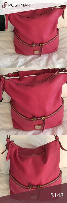 Dooney & Bourke large hobo bag Beautiful pink bag that has 2 pockets in front,very nice preloved gentle used bag that has some minor dirt inside and scuffs on the corner. Dooney & Bourke Bags Hobos