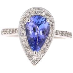 For Sale on - This ring has a gorgeous Pear Cut Tanzanite that weighs Carats. It is surrounded by 97 Round Cut Diamonds that weigh Carats. Elegantly set in Tanzanite Ring, Round Cut Diamond, White Gold Rings, Cocktail Rings, Pear, Heart Ring, Diamonds, Jewelry, Pretty
