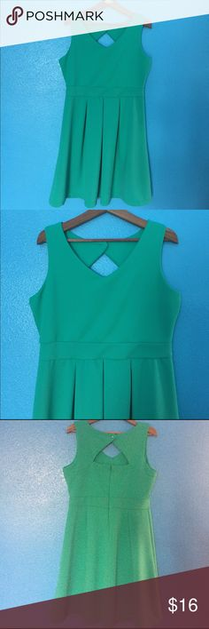 Spring green dress This sleeveless spring green size 14 metaphor dress is adorable with a scoop neck, banded waist for definition, a subtle waffle texture to the fabric, pleated skirt for some swing, and a back button over a key hole.  Perfect for spring and summer! The measurements laid flat are approximately 21 inches over the chest, 18 inches at waist, and shoulder to hem is 38 inches. Gently used and from a smoke free home. Metaphor Dresses Mini