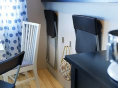 Small dining quarters? No problem. Try wall hooks to keep extra chairs handy.