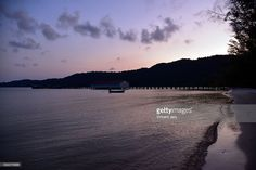 Coastline at sunrise with jetty Koh Rong Samloem, Cambodia, Southeast Asia.  #getty #gettyimages #purchase #moment #rf #photo #photograph #photography #koh #rong #kohrong