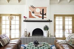 Step inside a colorful, boho-glam desert home in Scottsdale, Arizona designed by the duo behind Colossus. Estilo Hippie Chic, Hippy Chic, Bamboo Bed Frame, Stucco Fireplace, Fireplace Ideas, Fireplaces, Round Marble Table, Renovation Budget, Southwestern Home