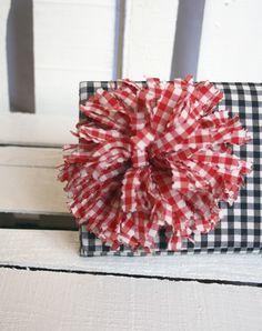 gingham red flower bow, add some raffia and maybe some more diff. ribbons too!