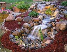 Nice little waterfall into a waterless pond for a yard.