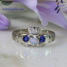 Hand made traditional Irish Claddagh in White Gold with blue sapphires and rainbow opal. Rainbow Opal, Celtic Wedding Rings, Claddagh Rings, Irish Traditions, Blue Sapphire, White Gold, Traditional, Handmade, Jewelry