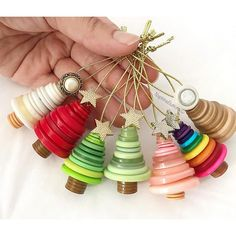 Button Tree Ornaments These button tree ornaments are made of brown buttons stump and different shades and sizes of colorful buttons. The top is made of a vintage round button, or star buttons. The button trees are finished in gold ribbon.  These fun and cute button ornaments come