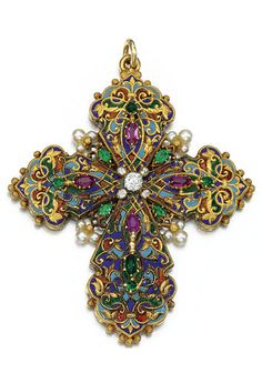 GEM-SET, ENAMEL AND DIAMOND PENDANT, CIRCA 1890 Designed as a Latin cross, the front and reverse decorated with polychrome enamel, accented with oval rubies, variously shaped emeralds, seed pearls and circular-cut and rose diamonds. #croix #bijoux