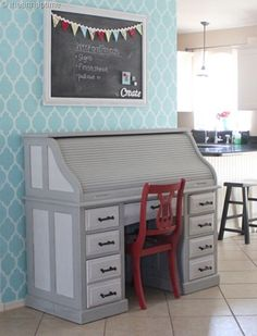 super cute stenciled wall...accent wall in the living room? I can paint the piece of furniture these colors and I can paint a red chair to go with the red accents in the room.