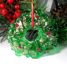 #bmecountdown This handmade Christmas wreath ornament was made by recycling a green wine bottle. It was made by first breaking the bottle and then fusing the