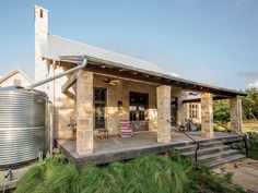 Home with RainWater Cistern, Raised Front Porch, Lueders Limestone and Galvalume Metal Roof. Design by Stephen B. Chambers, A., Specializing in Residential Architecture in Texas and Oklahoma. Metal Roof Houses, Metal Buildings, Stone Houses, House Roof, Rock Houses, Stone Cottages, Limestone House, Hill Country Homes, Ranch Style Homes