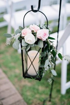 Romantic outdoor wedding ceremony aisle decor, light pink roses, black lanterns, white candles // Taylor Dane Photography