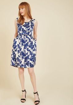It's a Fine Feline A-Line Dress. The difference between rocking this silky dress for a day of posh play and flaunting its ivory-and-cobalt cat print for a fancy affair is barely worth batting a lash about! #blue #modcloth
