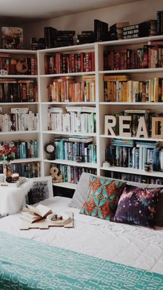 "oh-thebookfeels: "" My book nook for now (Before anyone judges my rainbow shelves… When you move 1600 miles and have to move again in a few months, you need some organization! I normally organize by author/series/genre though :). I also don't have..."