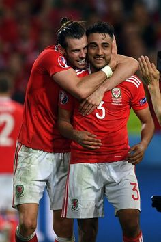Wales' forward Gareth Bale celebrates with Wales' defender Neil Taylor after the Euro 2016 quarterfinal football match between Wales and Belgium at. Real Madrid Soccer, Barcelona Soccer, Fc Barcelona, Welsh Football, Football Match, Neil Taylor, Bale 11, Rugby Men, Soccer Girl Problems