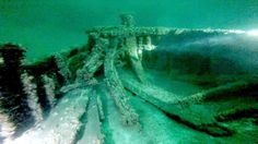 This image taken from video shows part of a 19th-century canal boat that lies on the floor of Lake O... - AP Photo/Bob Sherwood