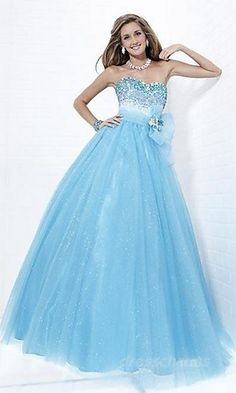 Now this is my modern Cinderella dress! Bule, puffy, strapless, and has that cute little flower on the side!
