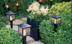 """Feng Shui garden. Would love to have those lamps. Makes the garden """"complete""""."""