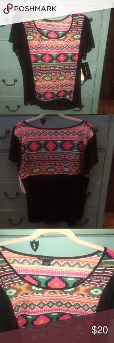 Sunny Taylor Short Sleeve Top w/ an Aztec Print XL Sunny Taylor Short Sleeve top with short sleeves and a cute Aztec Print.  Purchased at Dillard's and never worn.  Tags are still attached. Size-XL Sunny Taylor Tops