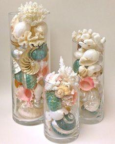 Beach Decor - Seashells, Coral and Starfish in Glass Cylinders / http://www.deerpearlflowers.com/fun-and-easy-beach-wedding-ideas/
